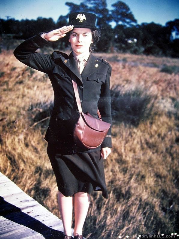 A WAC officer wearing the winter duty uniform, stands in salute. This replaces the first uniform authorized for the WACs: the major change being removal of the belt. The chocolate brown shoulder bag, brown leather gloves and shoes are the authorized accessories.: Shoulder Bags, Winter Duty, Color, Chocolate Brown, Brown Leather, Leather Gloves, Chocolates Brown, Brown Shoulder, Author Accessories