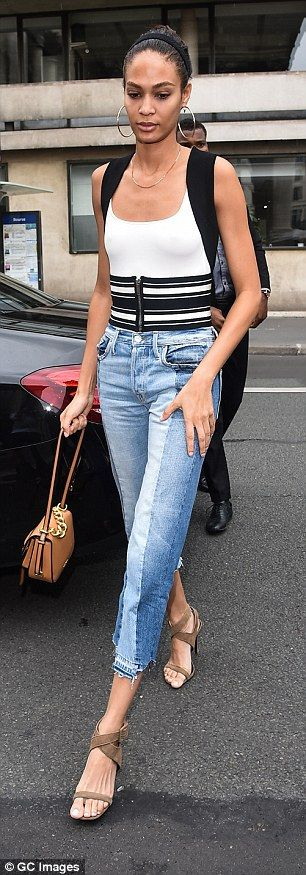 Lovely look: Joan Smalls meanwhile, wore a white vest top with striped cummerbund detail, ...