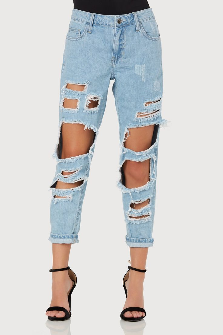 Trendy distressed boyfriend jeans with straight hem finish. 5 pocket design with front zip and button closure.