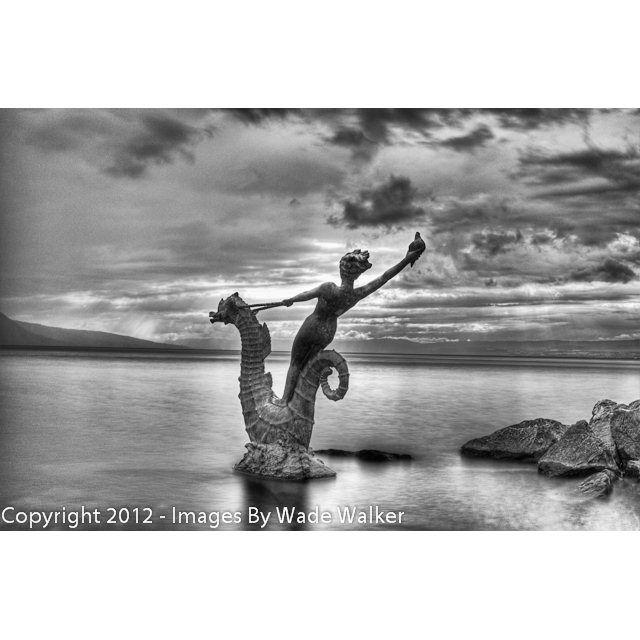 Lake Geneva shoreline statue, Vevey, Switzerland.    Photo taken by Wade Walker. Read my blog at http://imagesbywadewalker.blogspot.ch/.  Contact me at shop@imagesbywadewalker.com for orders of this photograph.  Please also visit www.imagesbywadewalker.com