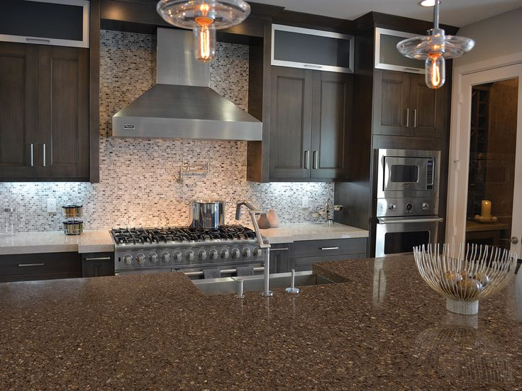 Contemporary Dark Brown Kitchen Cabinets With Light And Dark Quartz  Countertops.
