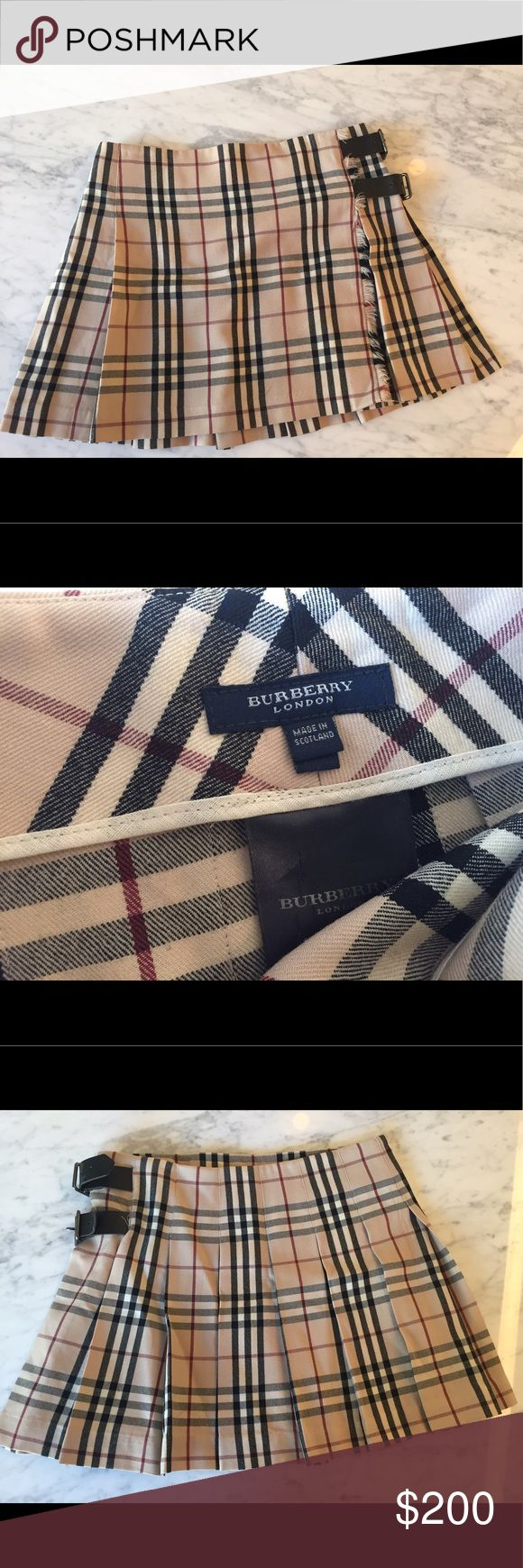 Burberry skirt UK size 12 (US 10). However, the leather buckles are adjustable and could fit a much smaller size as well. I am a US 0/2 and it is a little loose on me. Authentic Burberry. Bought 10 years ago but only worn a handful of times. Burberry Skirts