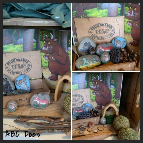 Away from your shelving, you can also create individual provocations based around children's interests or themes that you want to introduce.I created these in wooden crates for texture, linking this one to the story of the Gruffalo, enhancing it with story stones and various open ended small world items.