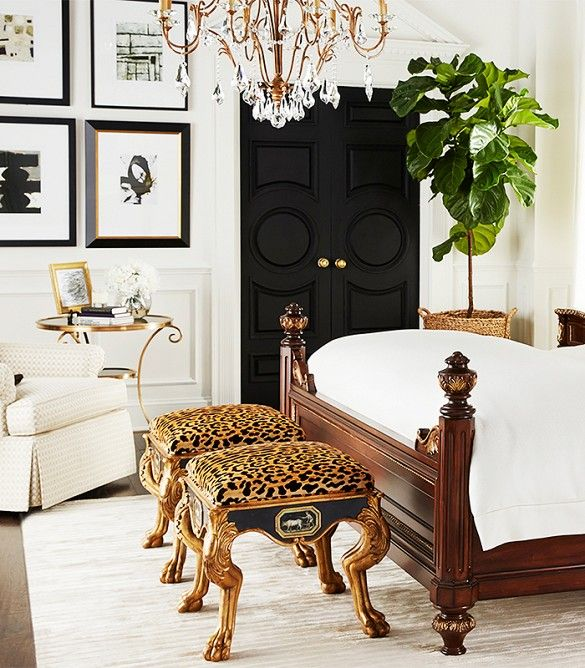 love these leopard stools with antique brass legs, complemented by the dark doors + glam chandelier