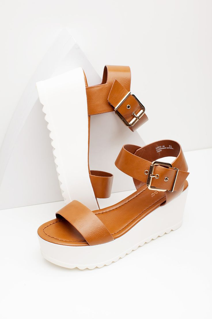 BOUTIQUE FIVE An on-trend flatform sandal, featuring a wide faux leather vamp strap and ankle strap with an oversized gold buckle. Lightly cushioned insole. Lug sole. Open toe and heel. $24.90