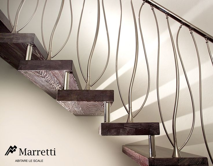 Wood Open Structure Cantilever staircase 16 - Open cantilever staircase without risers, with pickled oak steps and curved Gaudì-style three-branch banister in stainless steel.