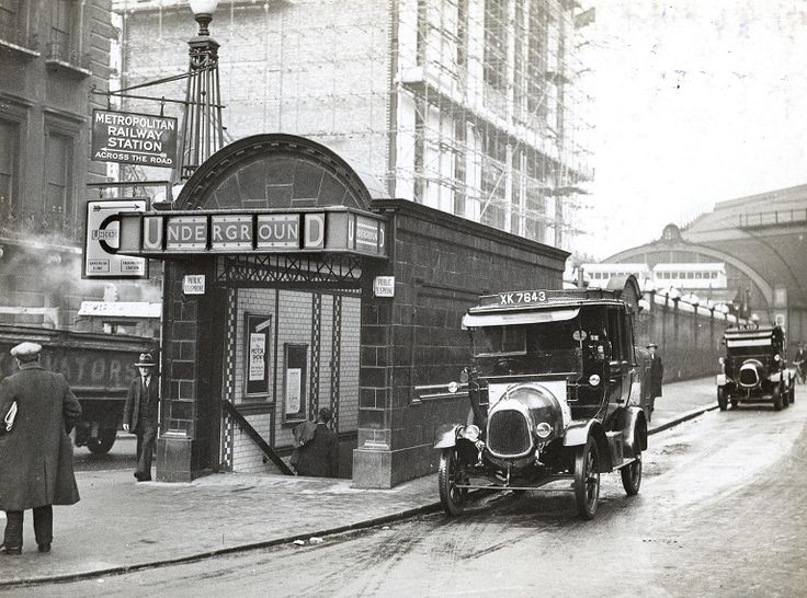 Two taxis are pictured outside Paddington Underground station, Bakerloo line subway entrance opening onto Praed Street, in 1932 © TfL from the London Transport Museum collection