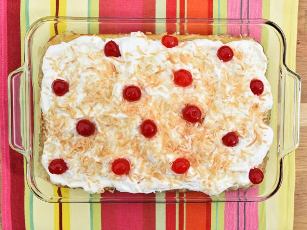 Get Pina Colada Poke Cake Recipe from Food Network