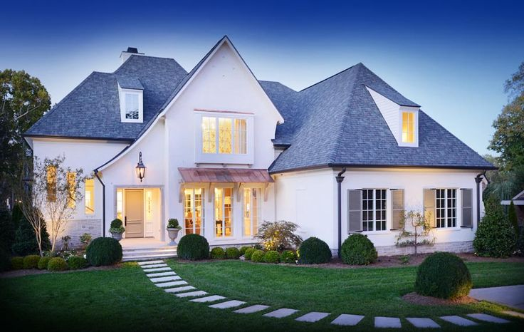 Check out the curb appeal on this Castle Homes house! Interiors: Rebekah Woodard, Atlas Interiors. Images: Reed Brown Photography. See more at www.StyleBlueprint.com
