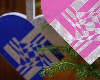 ketil bodvin from norway makes amazing heart-shaped paper cones to hang in the christmas tree!