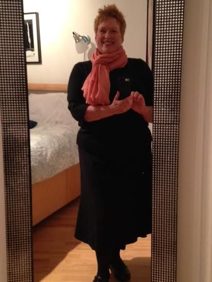 Day 185--Black Dillard's skirt, black 3/4-sleeve top, black tights, coral scarf, hammered silver earrings.