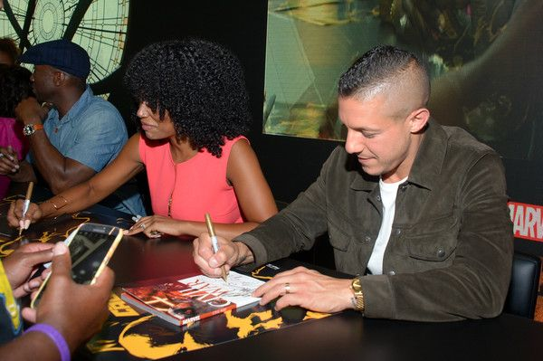 Theo Rossi Photos - (L-R) Actors Mahershala Ali, Simone Missick and Theo Rossi sign autographs during Netflix/Marvel's 'Luke Cage' panel at Comic-Con International 2016 at San Diego Convention Center on July 21, 2016 in San Diego, California. - Netflix/Marvel's Luke Cage at San Diego Comic-Con 2016  NETFLIX