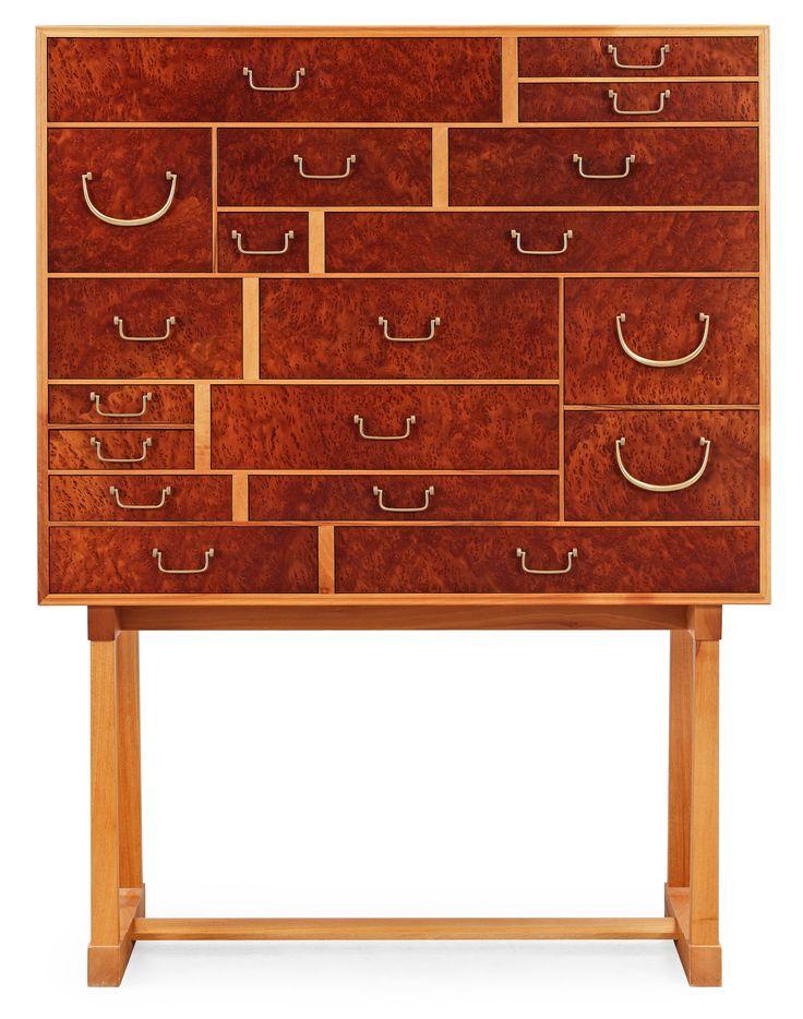 A Josef Frank 'National Museum' cabinet, Svenskt Tenn, model 881. Veneered with burrwood, mahogany and walnut, brass handles.