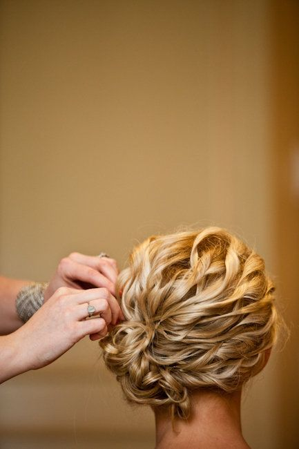 spiral curls gathered into a side bun   romantic and beautiful