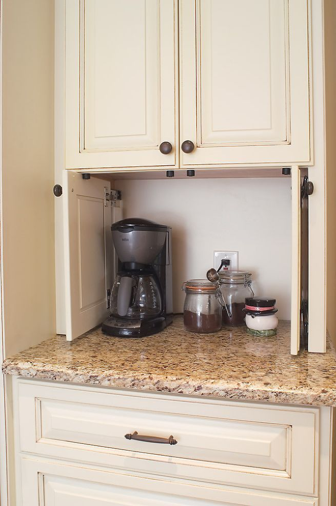 Coffee maker and supplies behind side pocketing doors by the microwave/oven©2013 Photography by JSPhotoFX