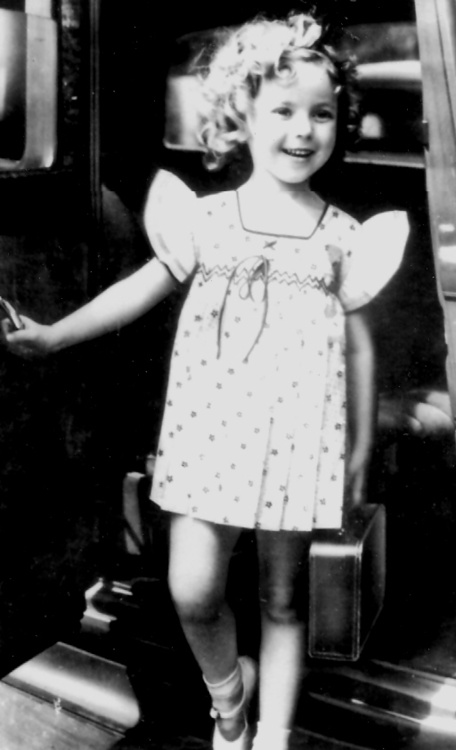 Shirley Temple arrives at the 20th Century Fox studio lot, 1930s.