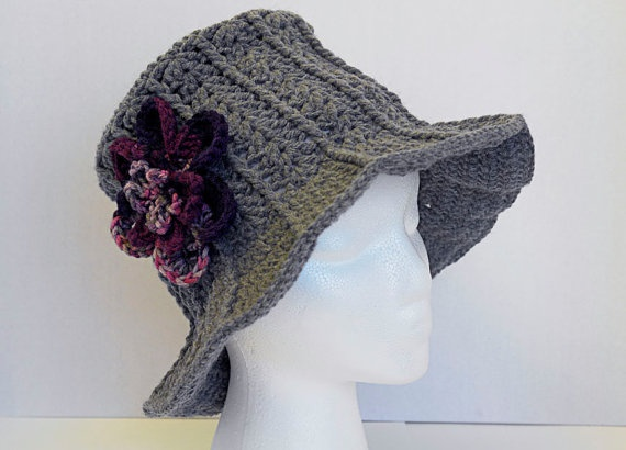 Grey hat with brim and purple flower