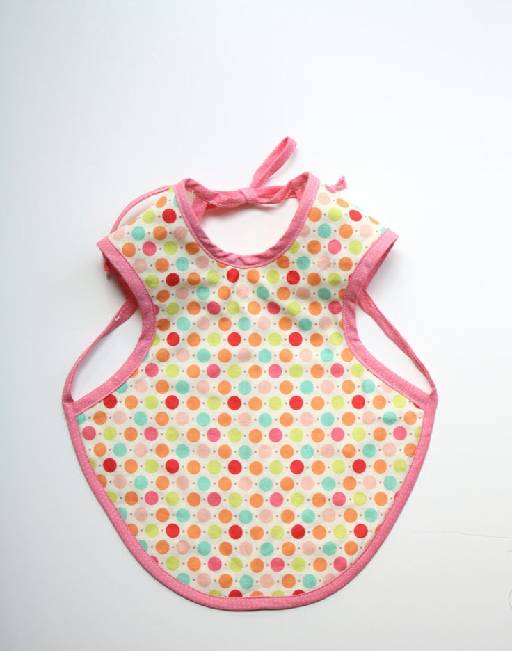 Found this on: http://www.craftinessisnotoptional.com/2011/05/bapron-tutorial.html    i must have these when i have kids.