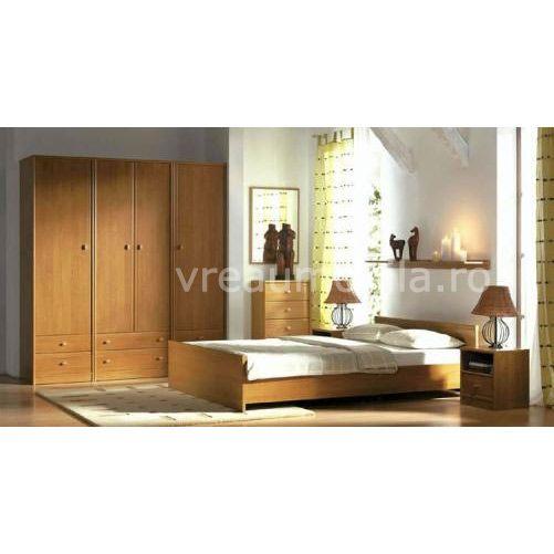 Poti alege un pat foarte inalt cu o saltea dubla, fiind o piesa de mobila de dormitor foarte potrivita.