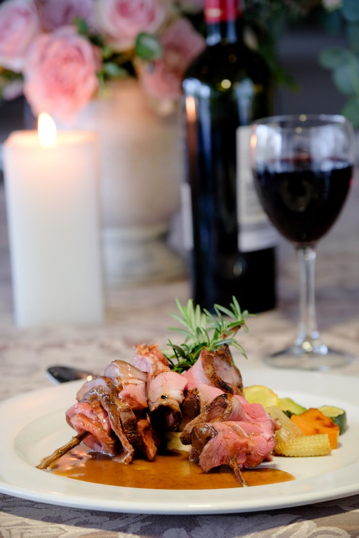 Sliced Roasted Leg of Lamb on a fresh Rosemary skewer with a Lemon and Garlic de-glace