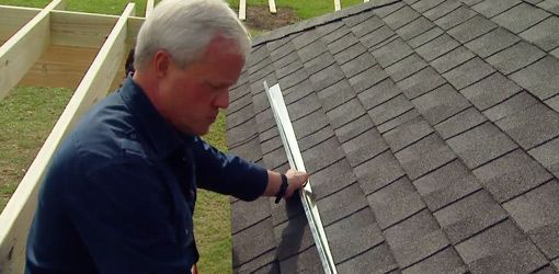 Find out how to install a sheet metal rain diverter over a doorway on your roof to divert rainwater away from the entry to your home.