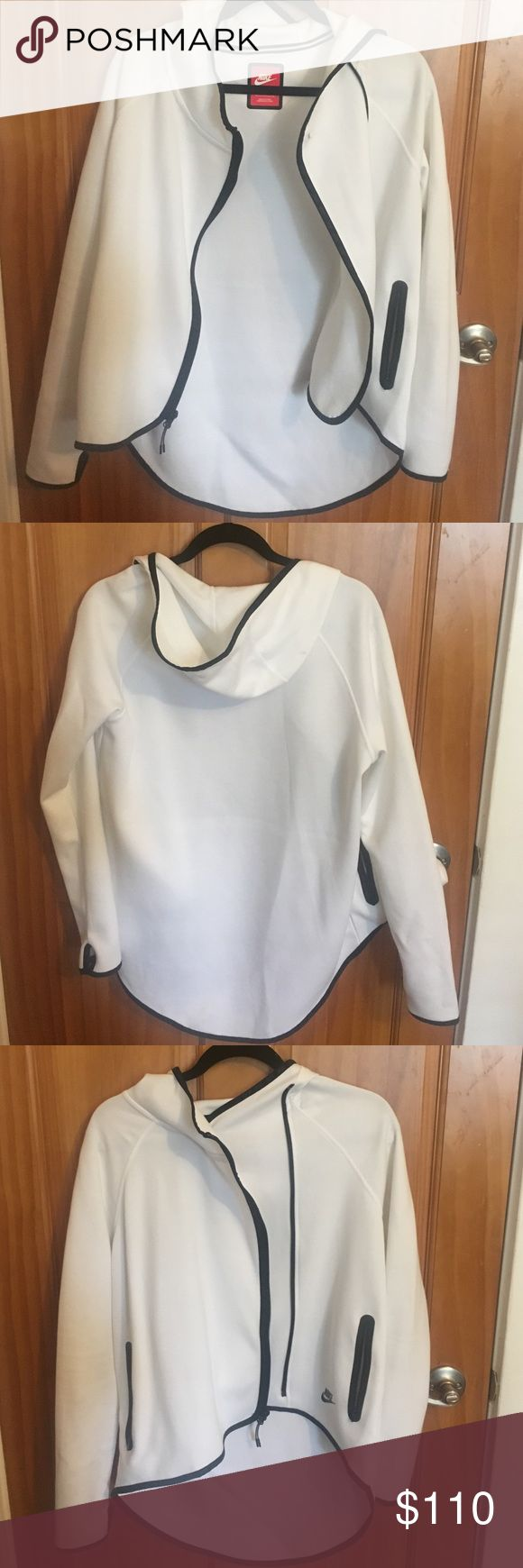 Nike Sports jacket Super chic, cool, loose fitting Nike jacket. Longer in the back. Thumb holes for when it gets cold. Zips in the front or you can button the top and keep the bottom open. Excellent condition!!! Nike Jackets & Coats