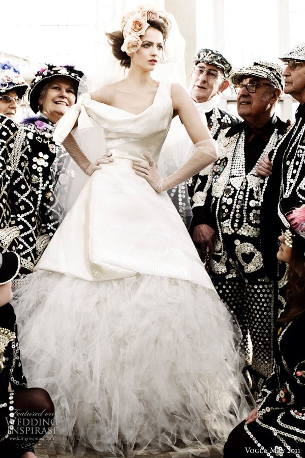 vivienne westwood wedding dress vogue - Model Irina in a silk gown with draped neckline and tulle underskirt by Vivienne Westwood, surrounded by Cockney Costermongers shot by Mario Testino for British Vogue Royal Wedding issue May 2011