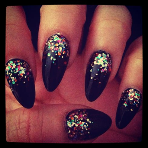 Almond nails with glitter on the top of the nail.