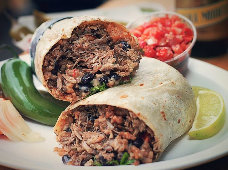 BEEF BURRITO. Flour tortilla filled with shredded bits of steak, rice, black beans, sour cream, cheese and pico de gallo.