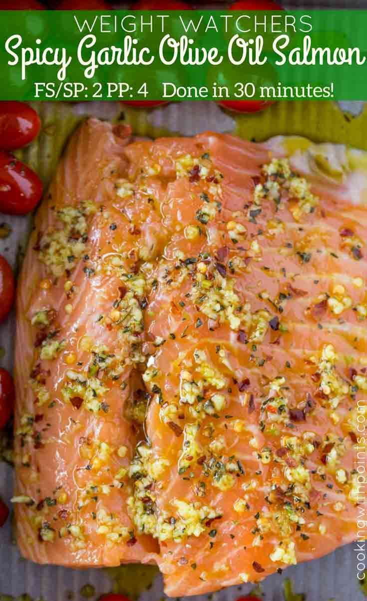 Spicy Garlic Salmon with burst roasted grape tomatoes is ready to cook in five minutes with a delicious spicy olive oil and garlic topping. Only 2 Weight Watchers smart points per serving.
