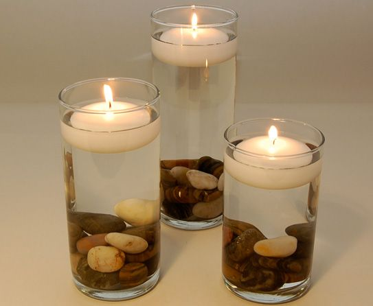Candles floating in a mason jar