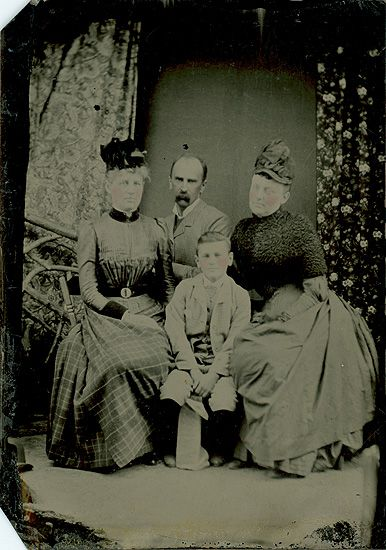 """Portrait of Sarah Woolley, William Osler, Grace Revere Gross (left to right) and William Francis (in front). William Osler had just taken the position of physician-in-chief at Johns Hopkins Hospital, and, after a visit to Toronto, travelled to Tracadie, New Brunswick in the company of his """"nephew"""", Francis, to inspect a leper colony there."""