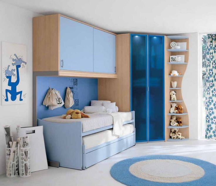 contemporary kids bedroom with blue accent design ideas for small room with round rug and space