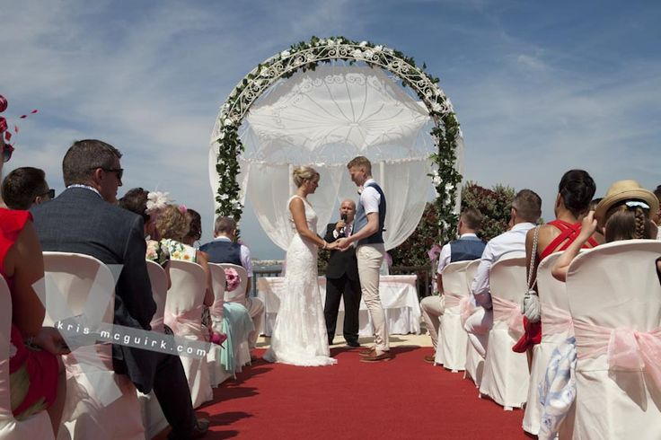 Carleen and David's wedding @Sunset Beach Club. Civil ceremony on the terrace of Sunset Beach Club Hotel with stunning sea view.Destination wedding photographer Kris McGuirk.