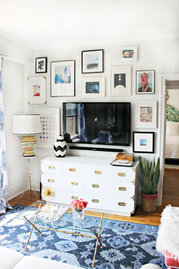 White campaign dresser, TV, and gallery wall. (This is nearly the exact set up I have planned for our master bedroom.)