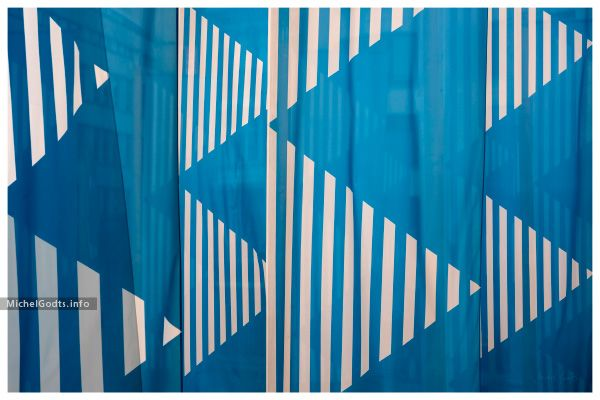 Photo composite of blue and white flags, part of a permanent art installation in Brussels, Belgium. Abstract realism photography prints for art collectors or for a wall decor.