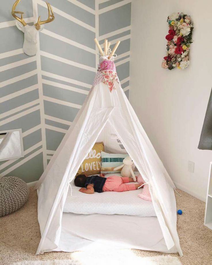 Crib mattress on floor in tent.                                                                                                                                                                                 More