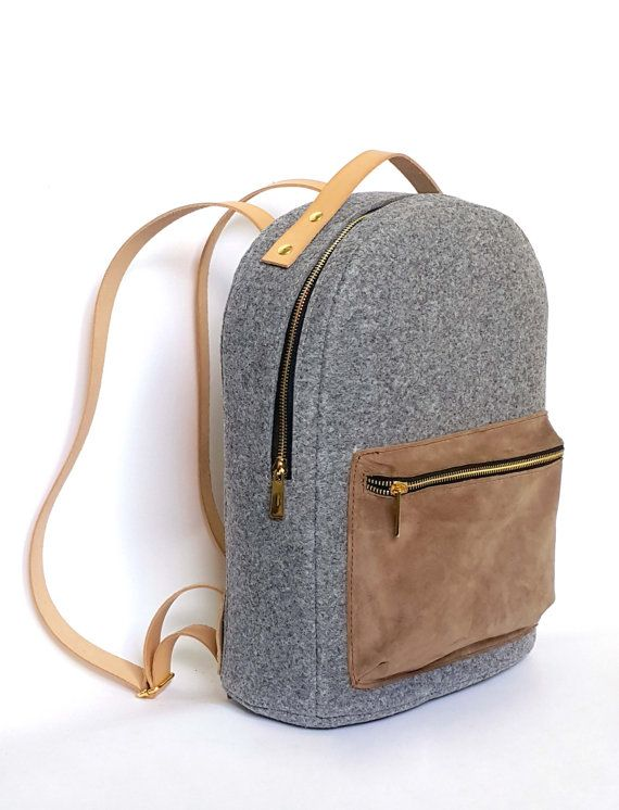Backpack made of high quality full grain leather, felt and shammy leather.  Closes on the zip.  It has got regulated straps.  Size: 36cm x 28cm x 18cm    All products are handmade in our manufacture in Poland  Best material and quality.