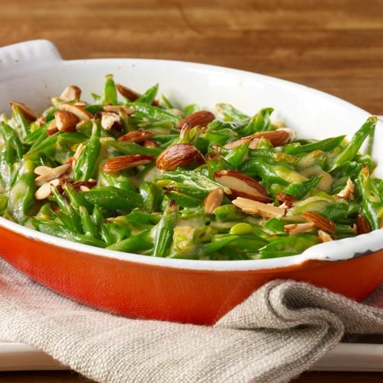 Green Bean Casserole with Goat Cheese, Almonds and Smoked Paprika | Inspired by classic green bean casseroles from his childhood, F&W's Justin Chapple put a Spanish spin on this timeless favorite by topping the creamy beans with smoky pimenton de la Vera and toasted almonds.