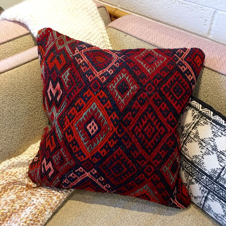 """Beautiful one of a kind pillow created from a handmade vintage Turkish Kilim Rug. No two pillows are exactly alike. Perfect for the modern bohemian home. - Approximately 20"""" x 20"""" - Ships without stuf"""