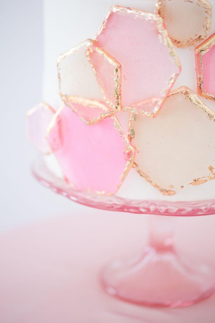 Cake with fun geometric pink and gold design