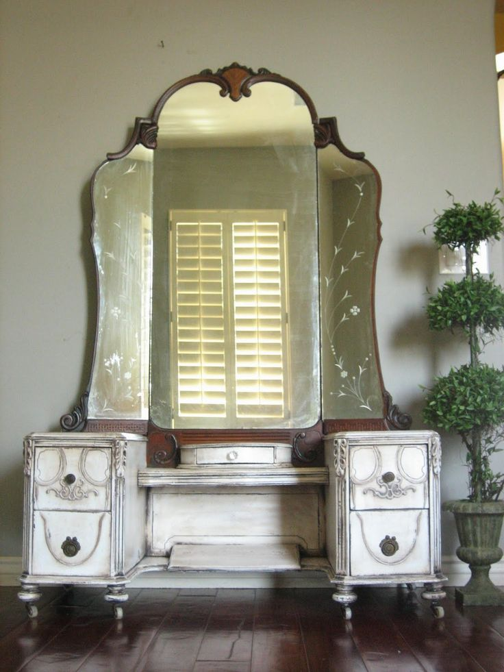 SOLD ~ Beautiful dressing vanity in an antiqued ivory finish with a heavy  glaze giving it a timeless aged appearance, complete with