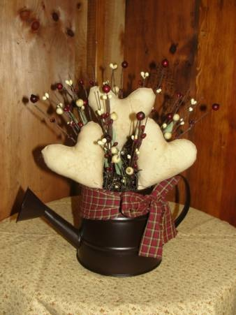 grungy hearts in watering can valentine decorationsvalentine
