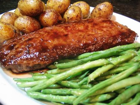 Asian-Style London Broil  Ingredients: 1 large (1-1/2 to 2 pound) flat iron or flank steak 1 teaspoon salt 1/4 teaspoon cracked black pepper 1/4 cup light or golden brown sugar 1/2 cup soy sauce 1 teaspoon Sriracha or other Asian-style hot sauce 1 tablespoon dark sesame oil Cilantro