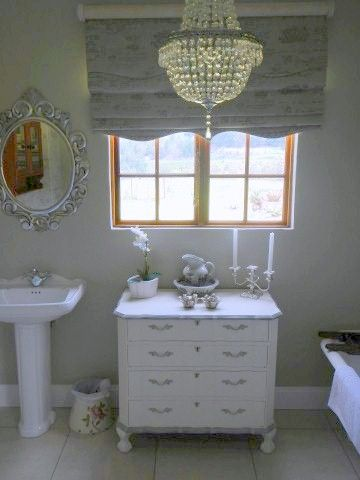 A mix of old, new, and restored items create a beautiful bathroom by Renaissance antiques, Midlands Meander, KZN, South Africa. Visit www.midlandsmeander.co.za