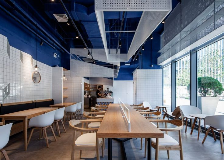 swimming pool studio aimed to bring the relaxing and refreshing hues of blue sea restaurant designshanghaicafe