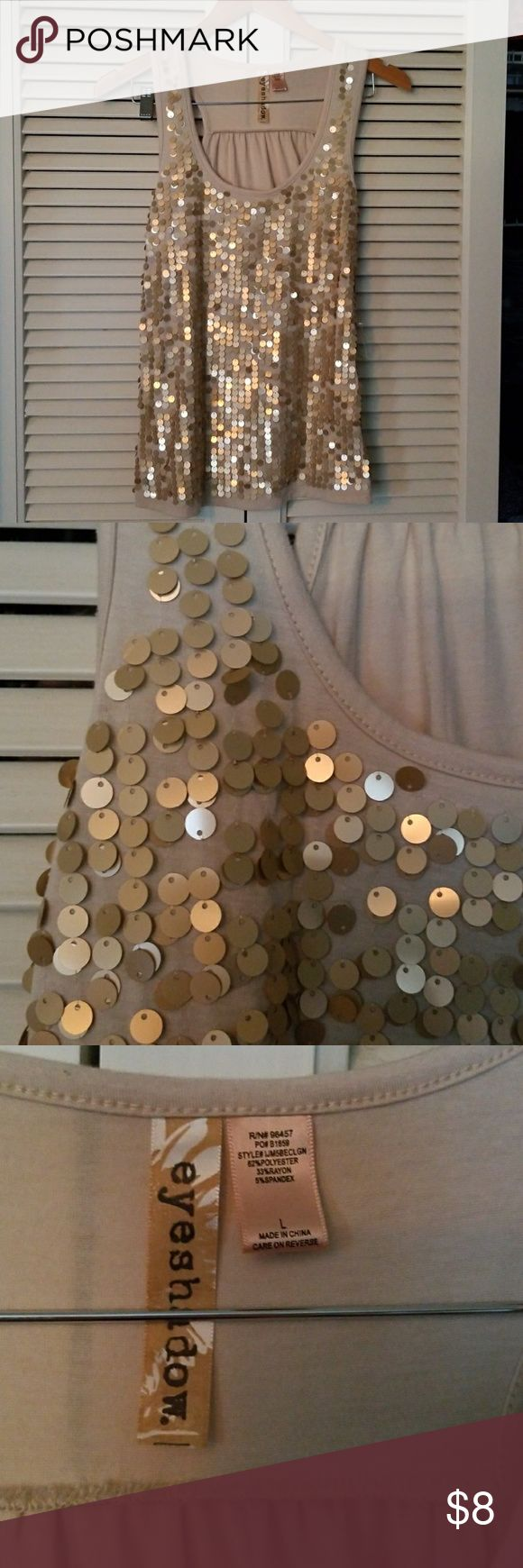 Sequin Tank Top Tan tank top with goldish sequins on the front only. Fits true to size. Eyeshadow Tops Tank Tops