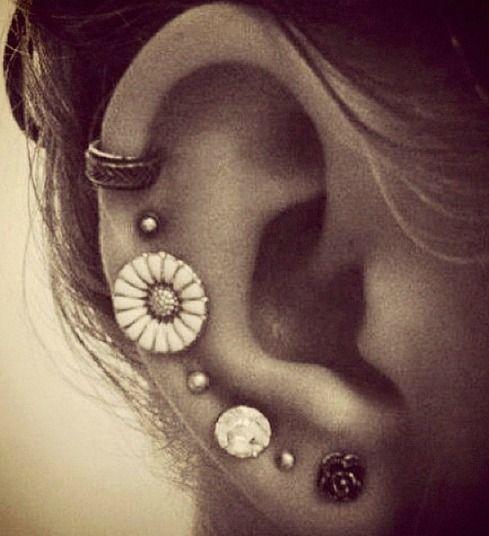 Love these many ear piercings