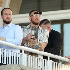 UFC World Champion Conor McGregor watches horse racing at the Grand National meeting at Aintree