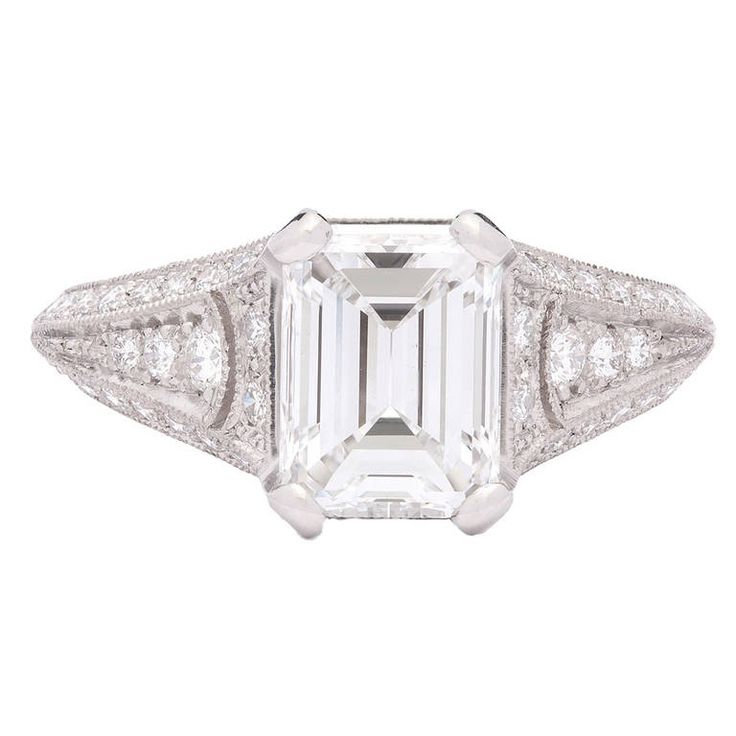Sebastien Barier Emerald Cut GIA Diamond Ring Colorless 1.77ct Emerald Cut Diamond in a Finely Crafted Custom Sebastien Barier Platinum Setting with 60 Additional Round Brilliant Cut Diamonds for 0.76cts.